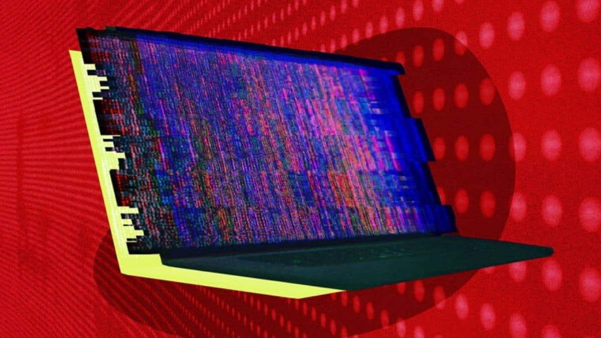 kırmızı ekran üzerinde bir bilgisayar